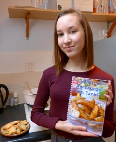 Georgia Thomas holding cookbook