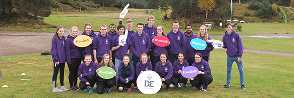 a group of young people in purple hoodies with DofE signs