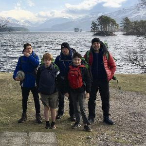 Boys and leader outside at a loch