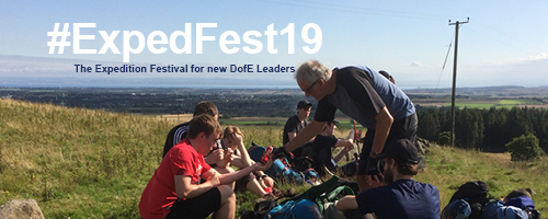 Expedition Festival promotion. DofE Leader with participants on expedition.