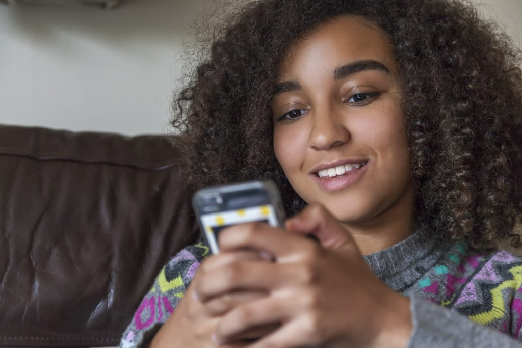 Young person on mobile phone