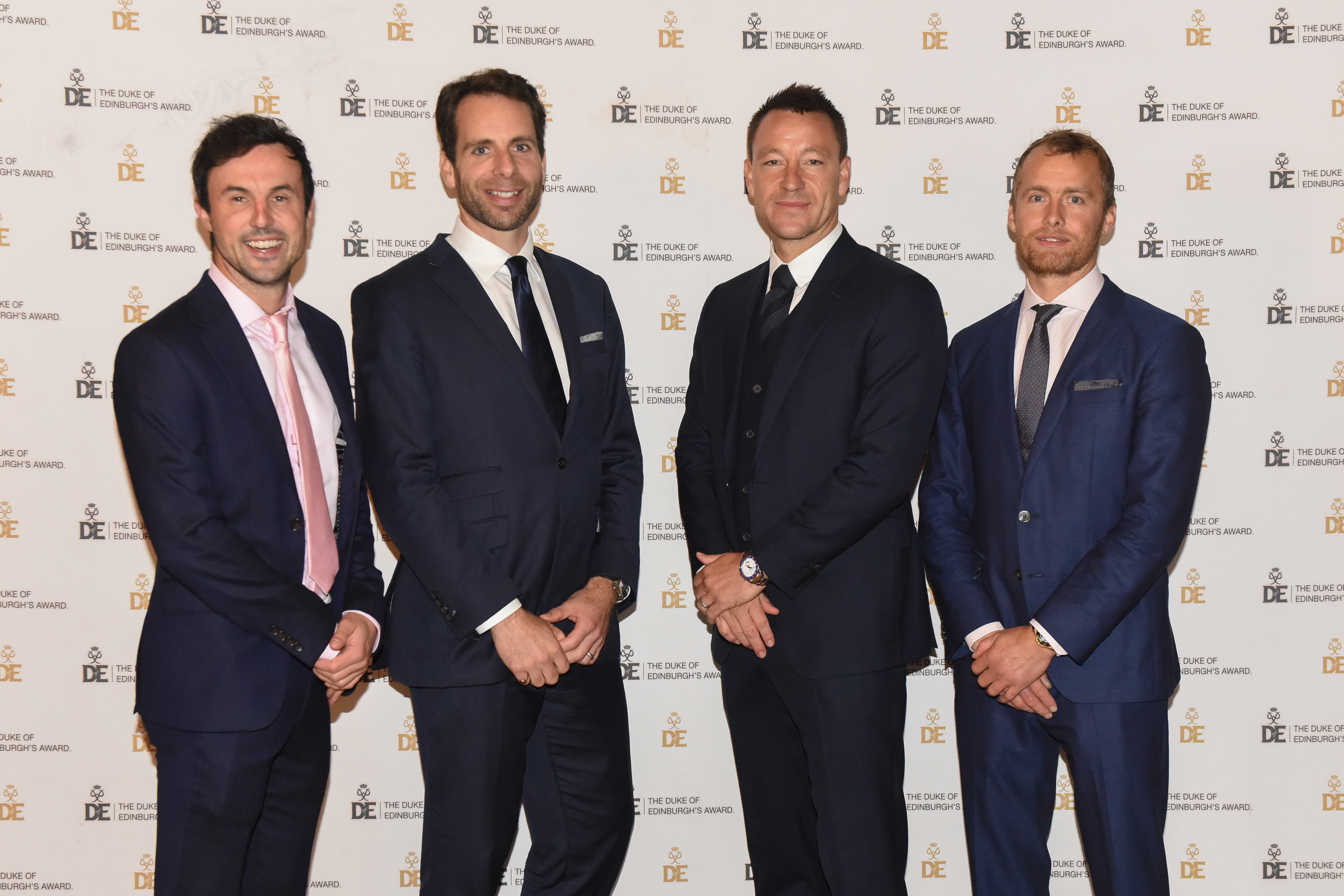 Group photograph at Gold Award Presentation of four male presenters