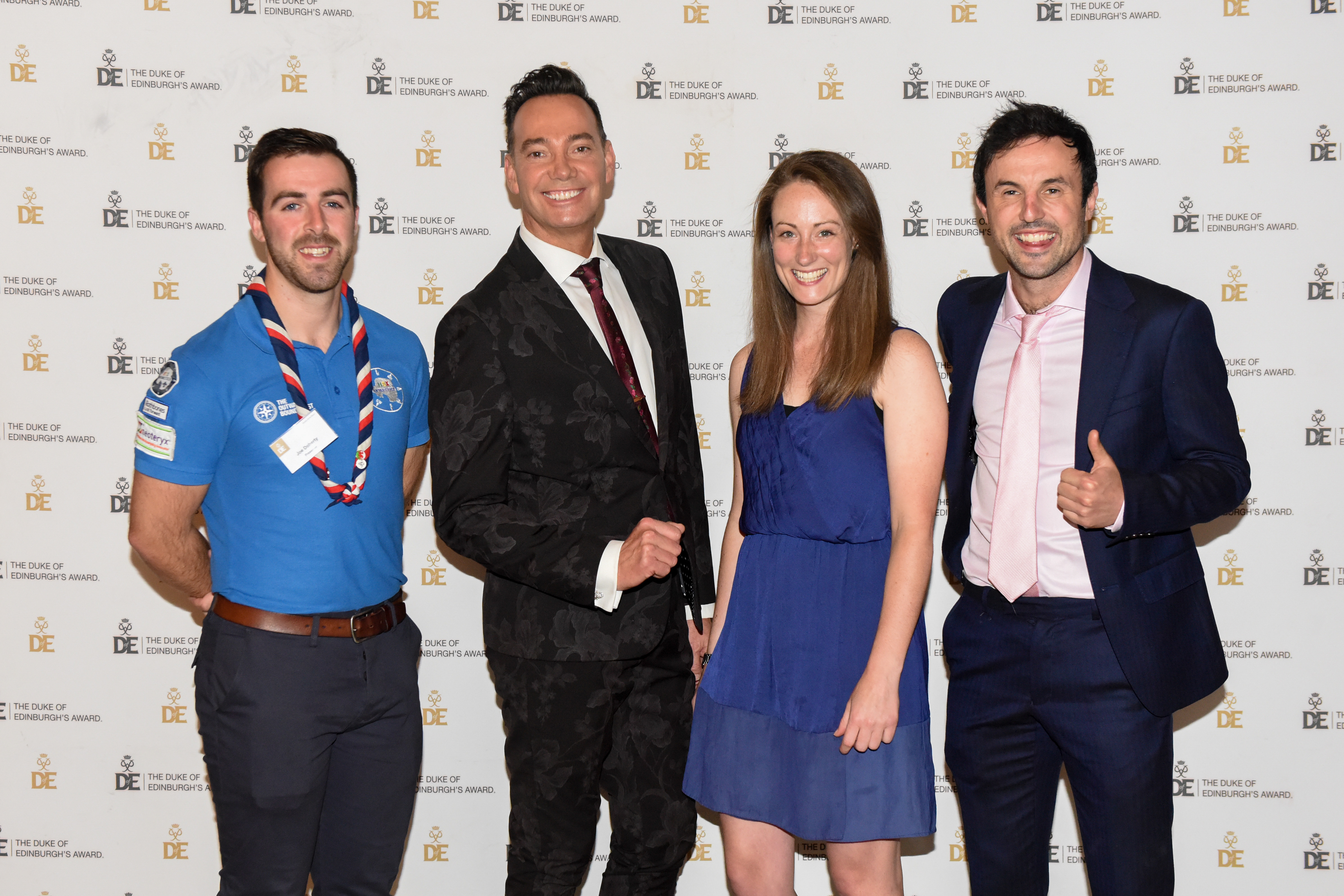 Group photograph at Gold Award Presentation of three male and one female presenters