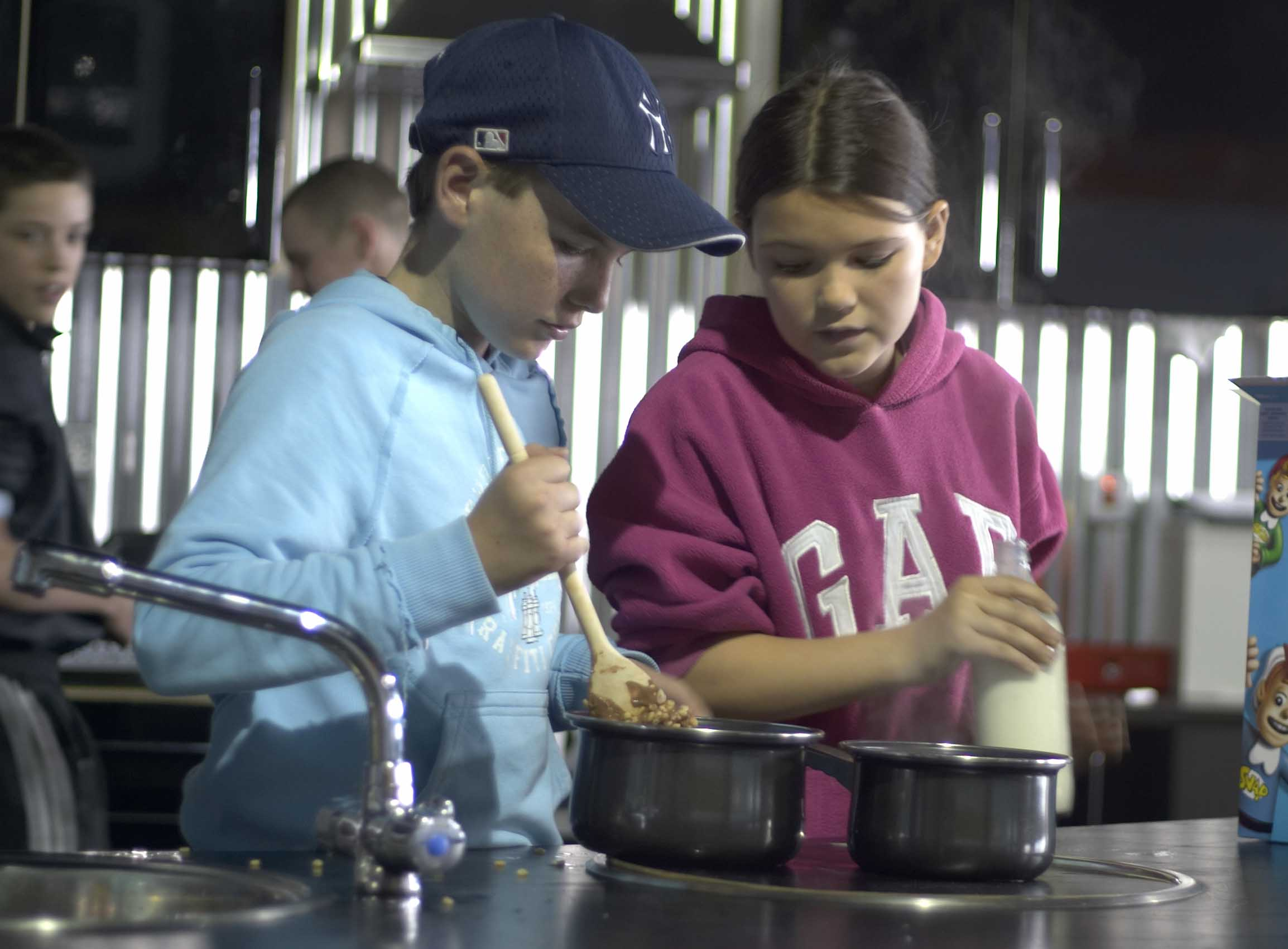 Young girl and boy in cooking class