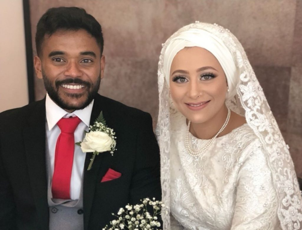 Naeema and Mo at their wedding in formal attire