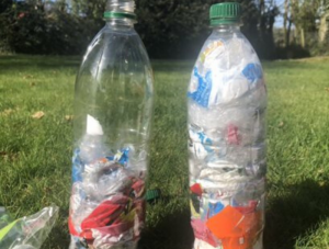 Two plastic bottle with wrappers in