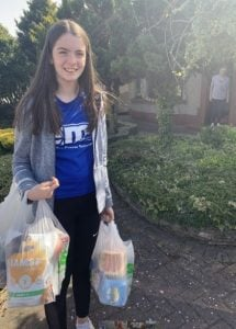 Poppy holding bags of shopping