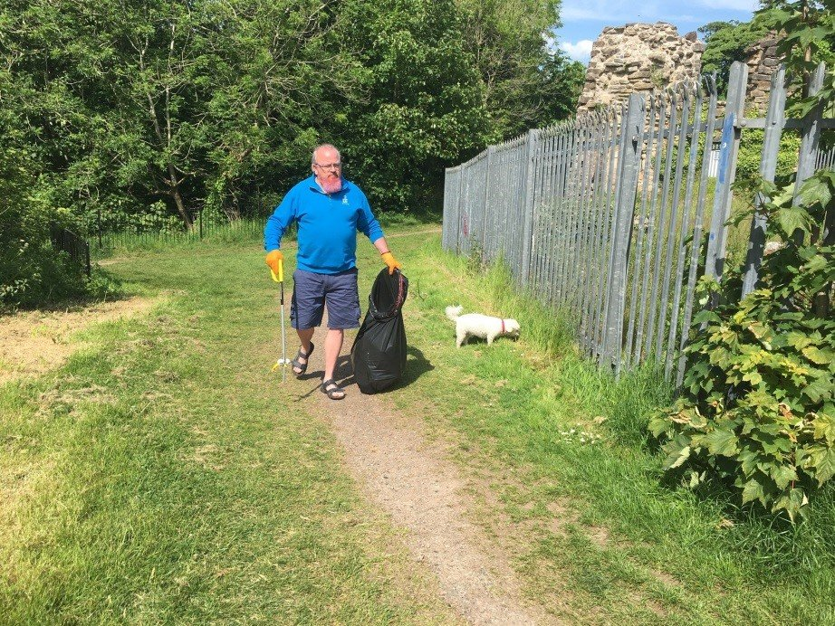 Kevin litter picking in blue shirt