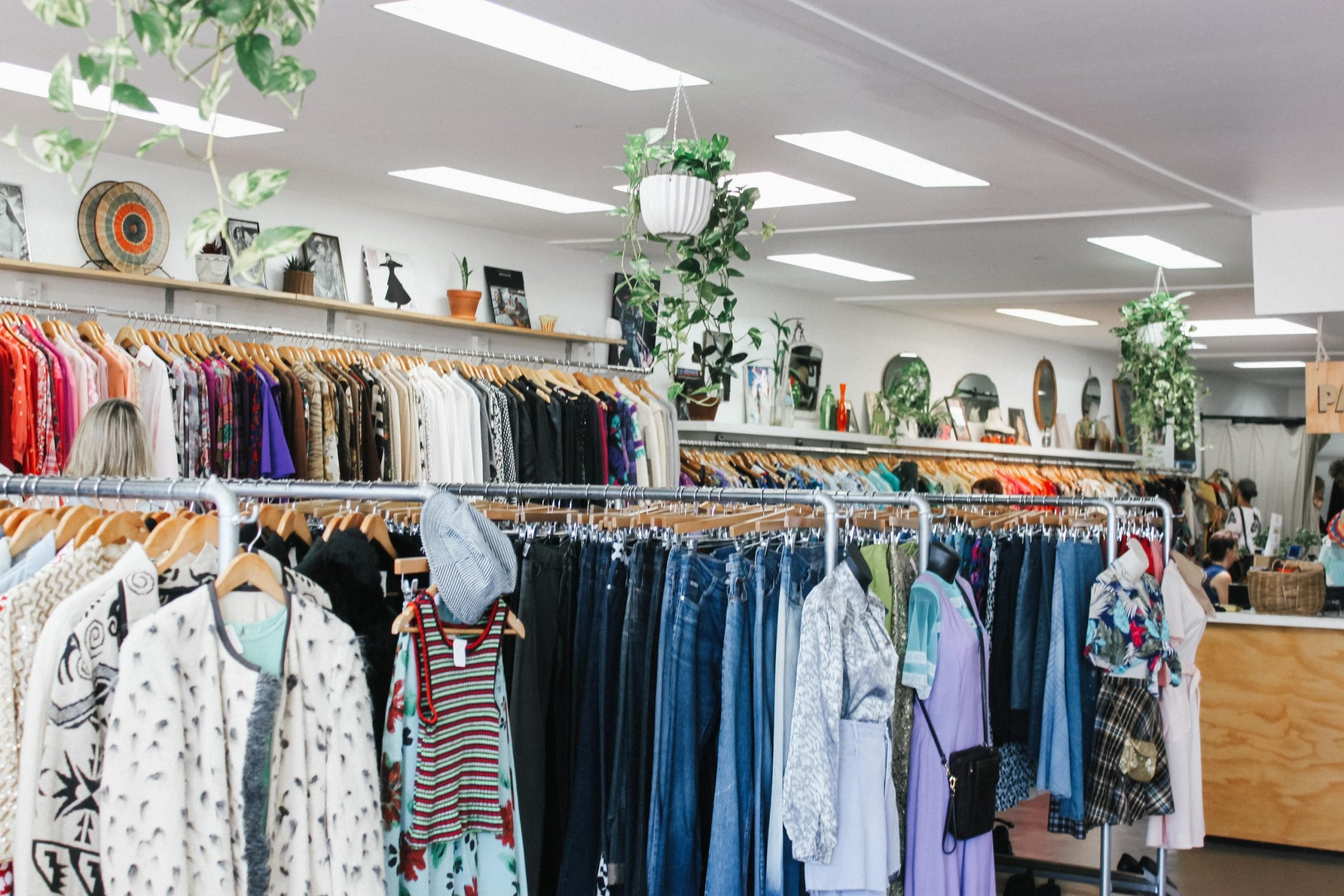Interior of a charity shop with clothes rails
