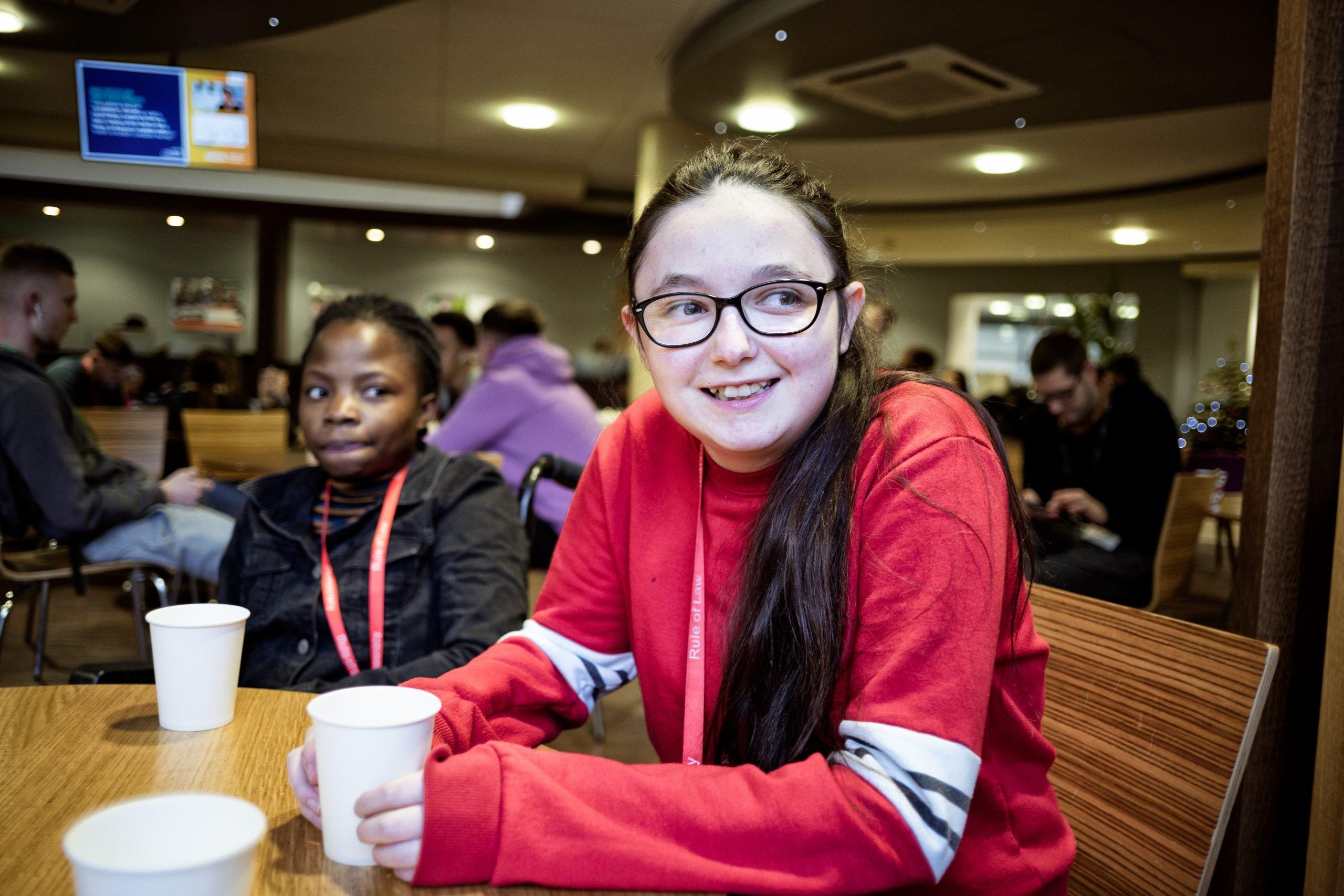 Happy smiling female teenager in red hoody