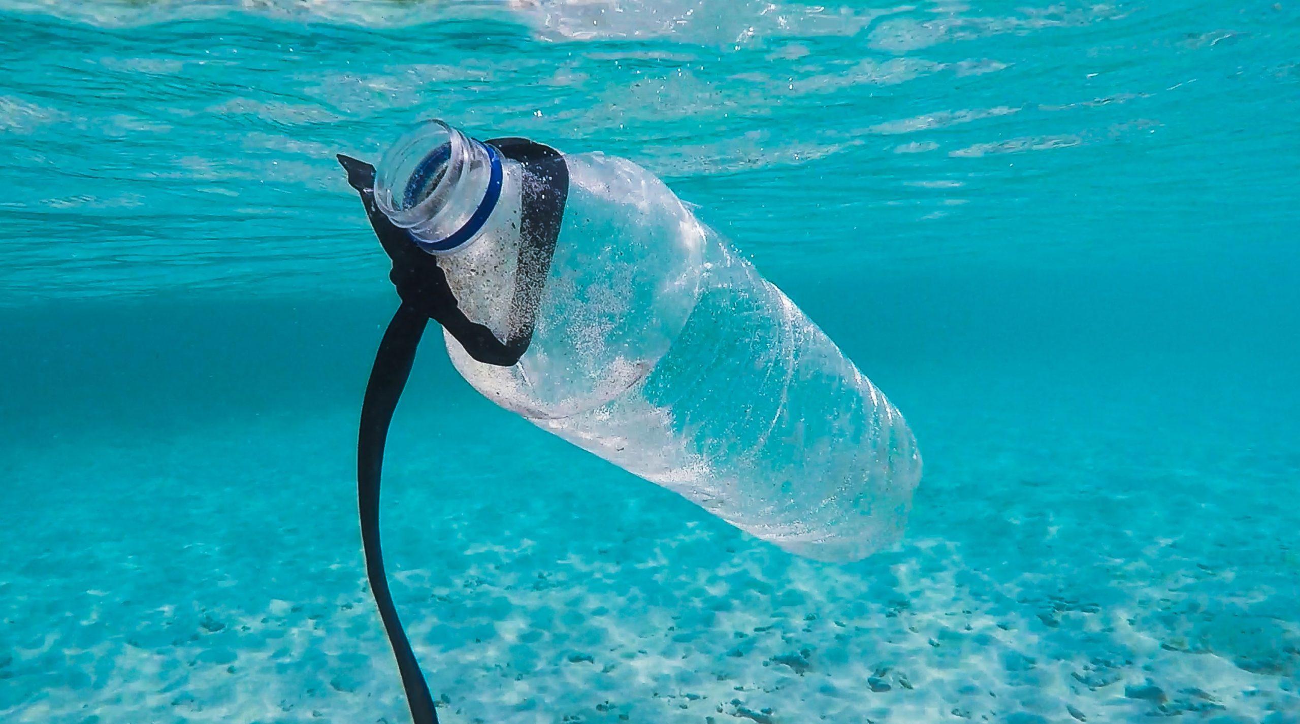 Plastic bottle floating in the ocean