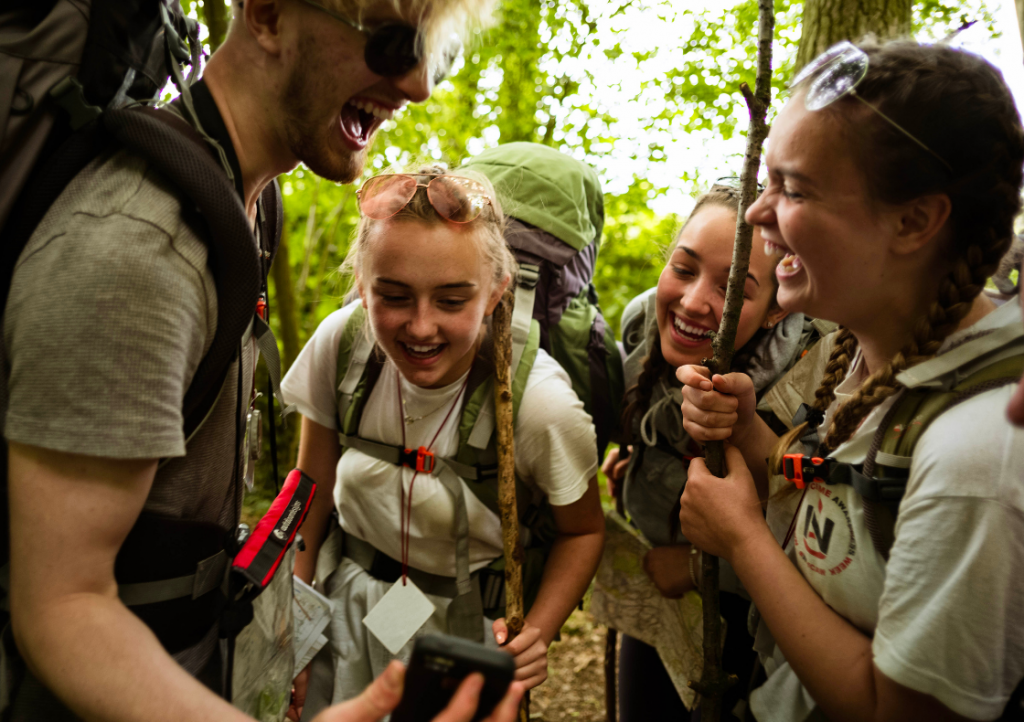 Group of young people on expedition laughing