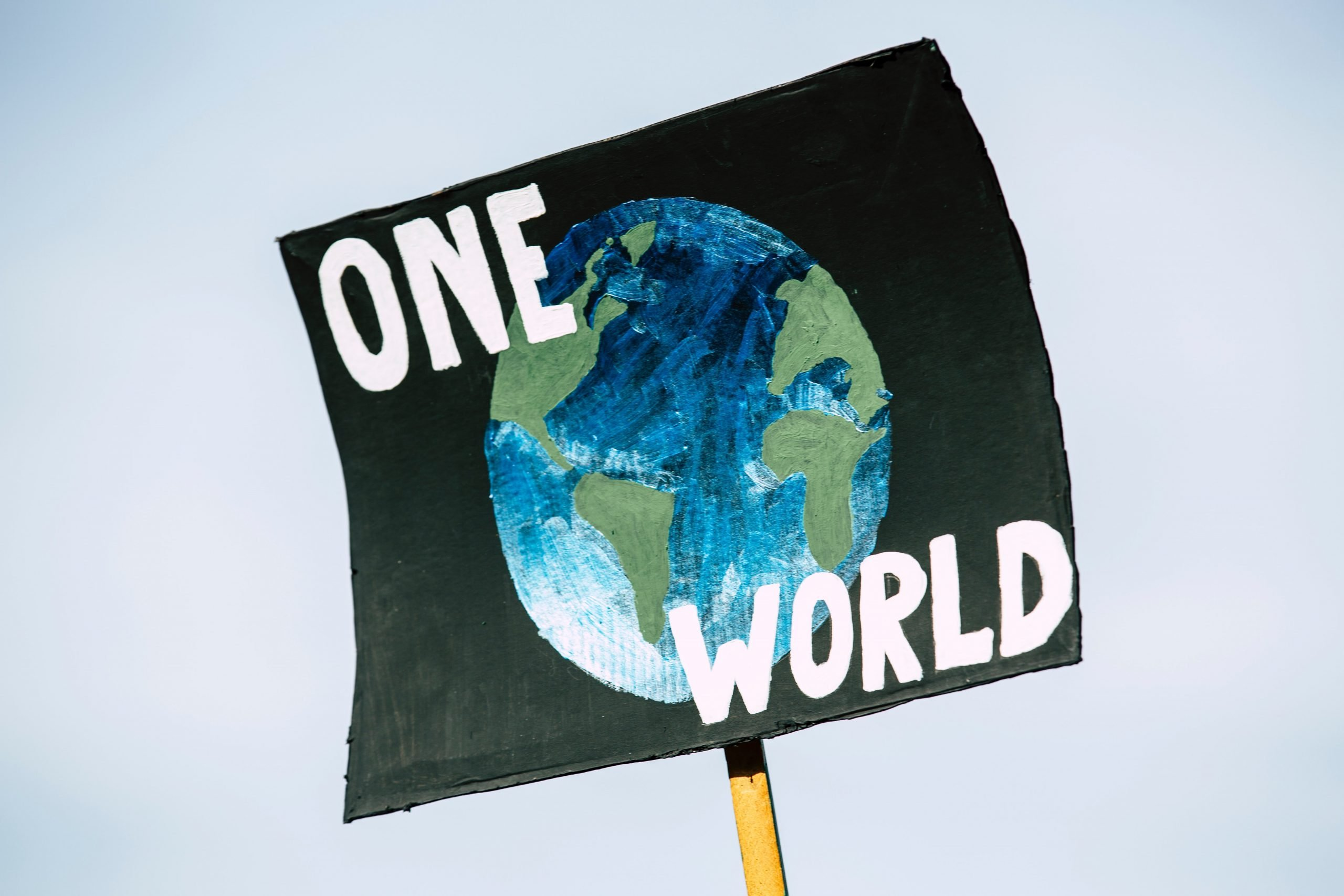 Poster of One World globe