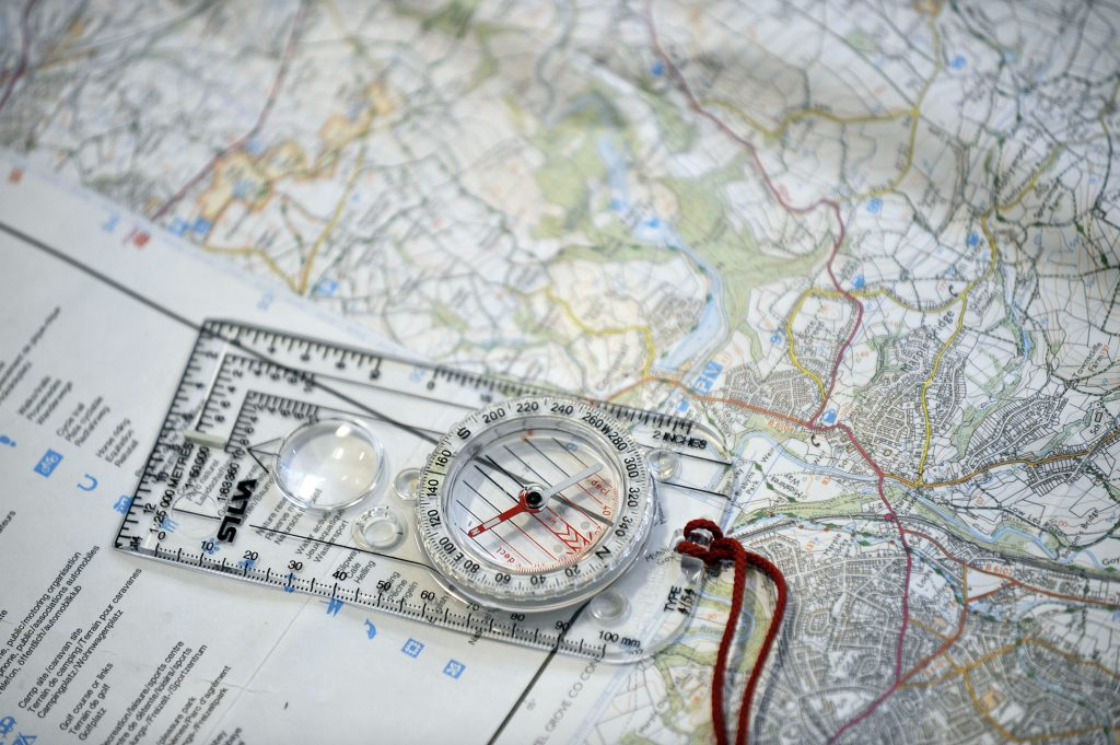 Close up photo of a compass on a map