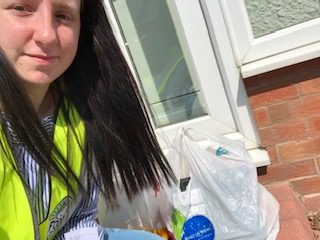 Amy with a delivery of goods for the food bank.