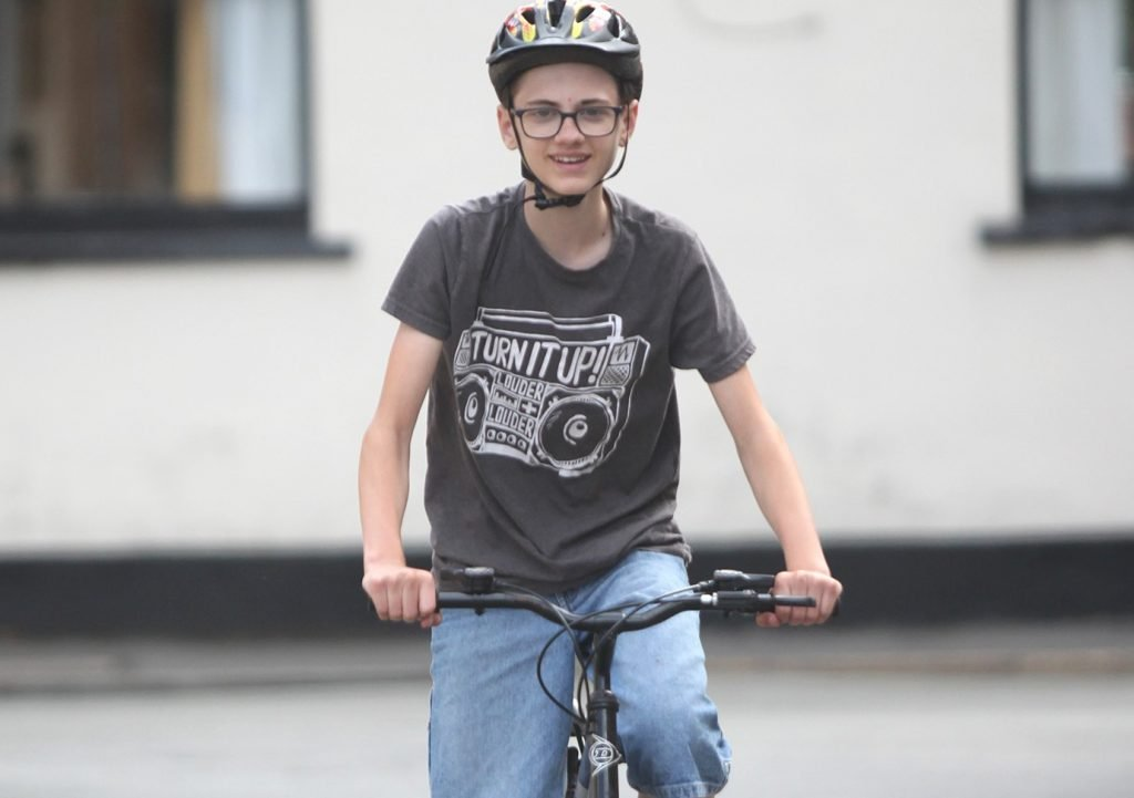 Frankie cycling with helmet for Physical section