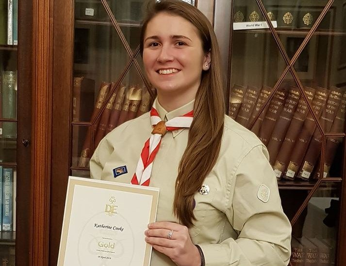 Katherine in Scout uniform holding Gold DofE certificate