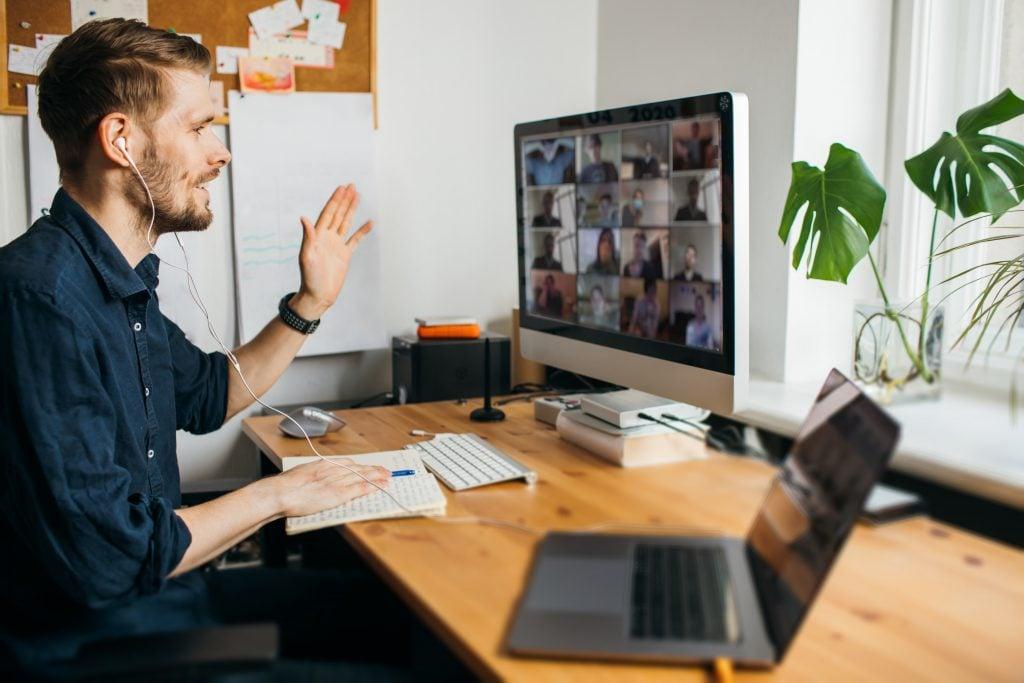 DofE Leader sitting at desk on video chat