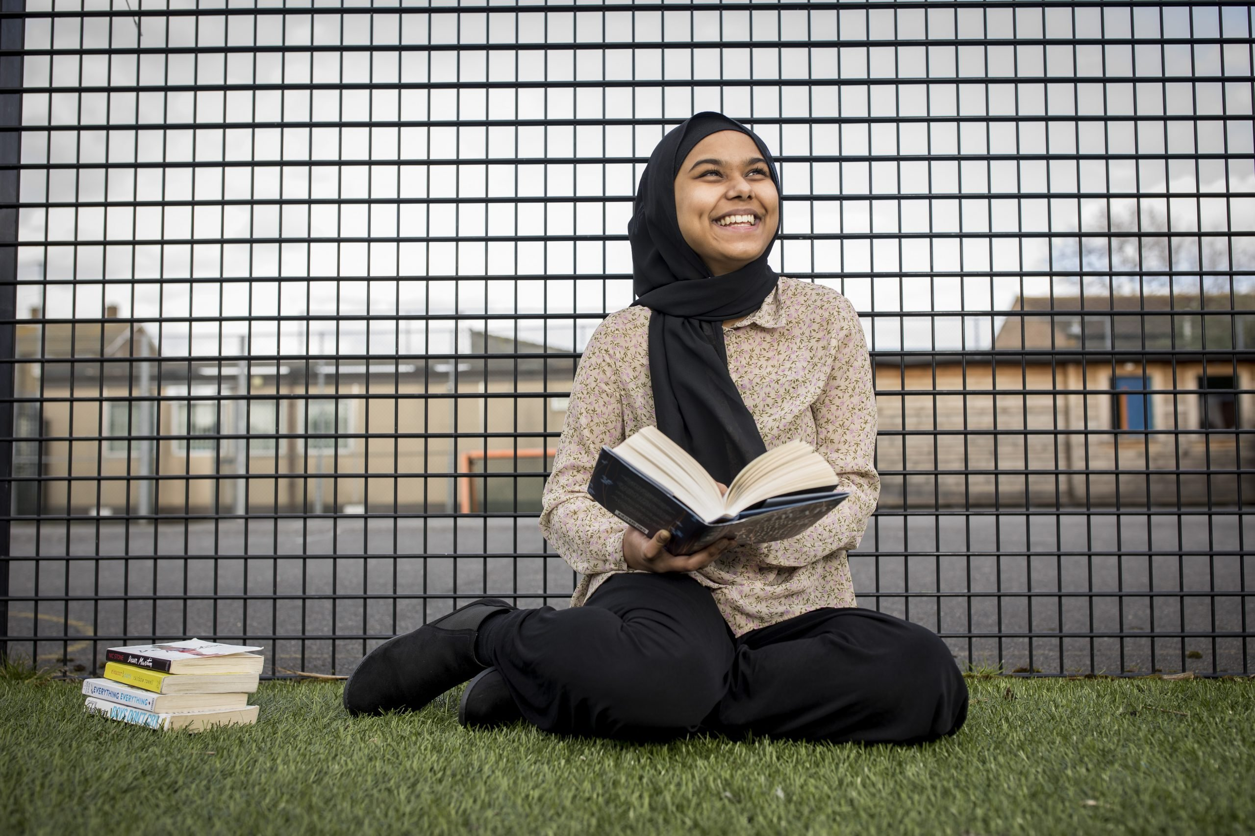 Young female participant reading book