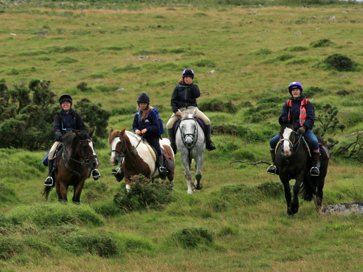 Group of young people riding horses at Dartmoor