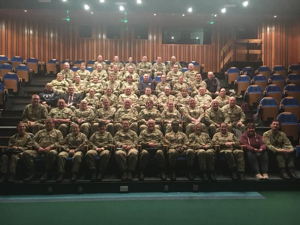 Large group of Army Cadets from ACFA wearing uniform sat in theatre style seats