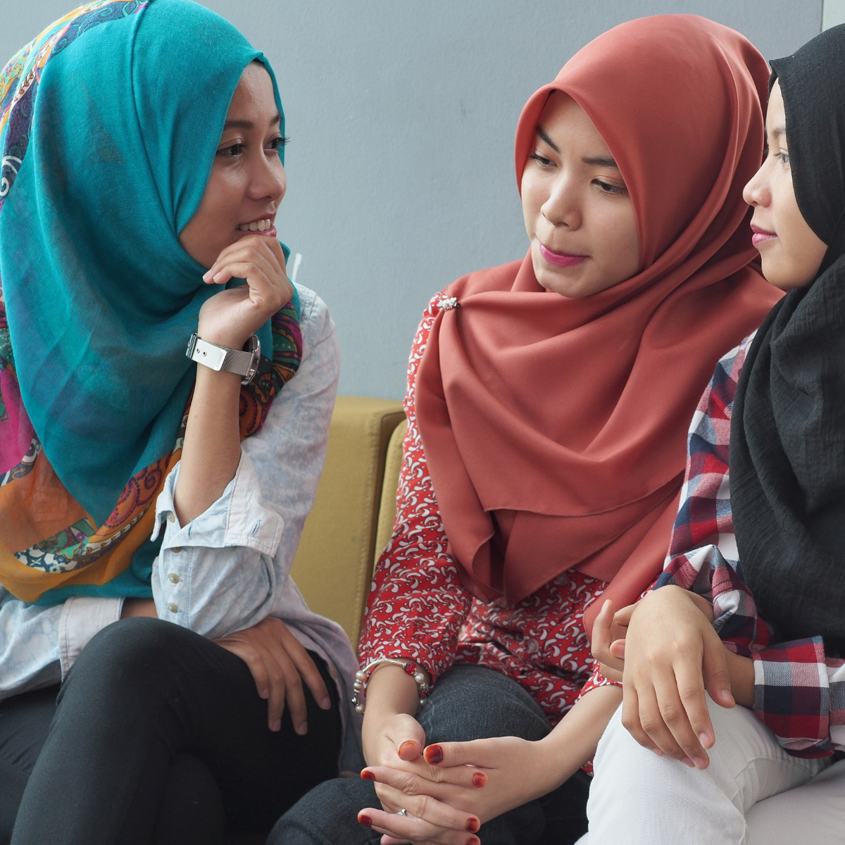 Three young women talking