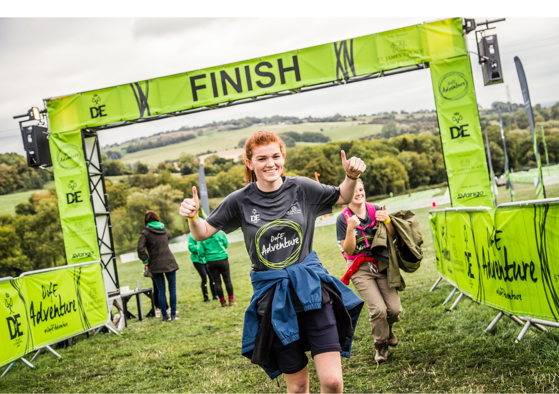 Woman with thumbs up at DofE Adventure finish line