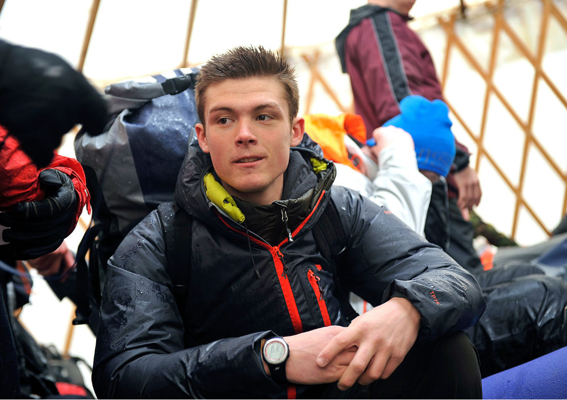 Young man with backpack on expedition