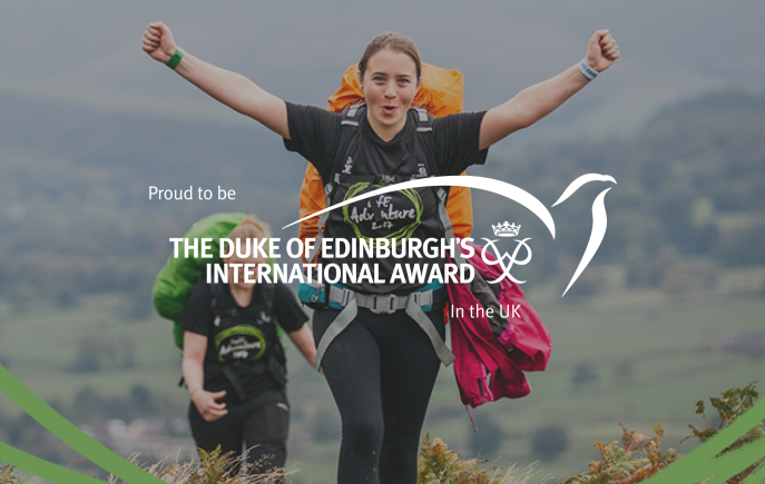 Young woman at top of hill with arms in the air celebrating, overlayed with text that says Proud to be The Duke of Edinburgh's International Award in the UK