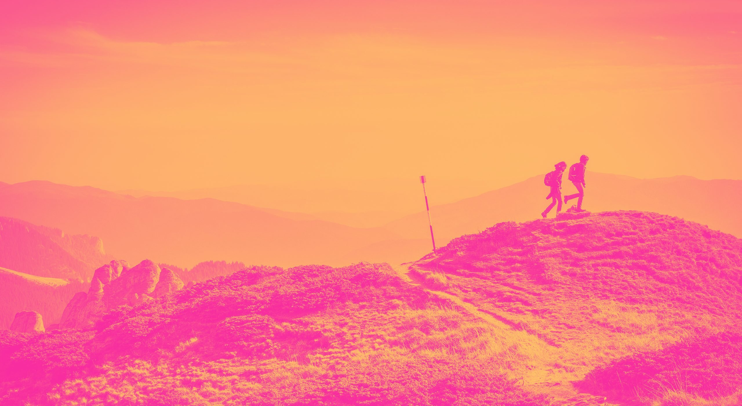 Two hikers on a hill