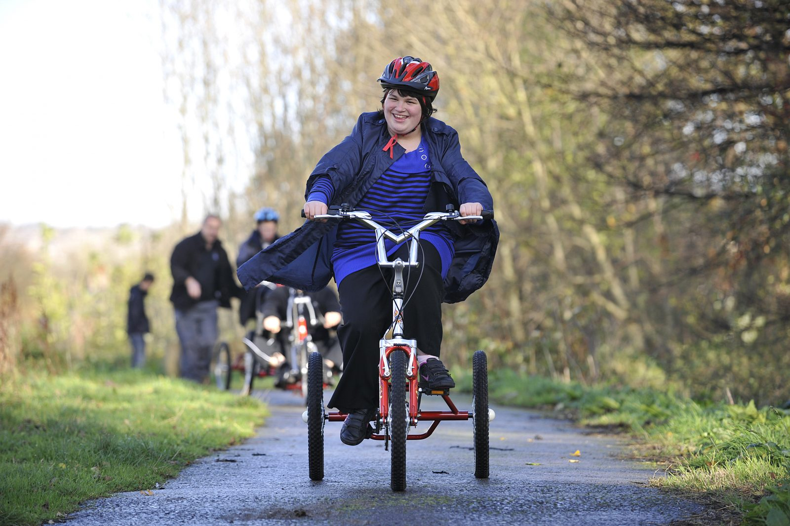Young woman with additional needs cycling
