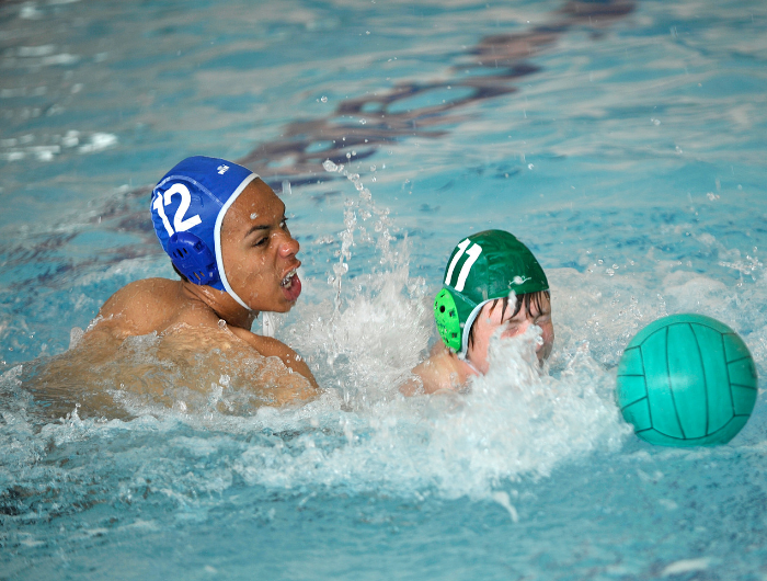 Two boys playing water polo