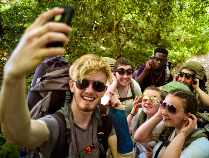 Group of young people on their DofE expedition posing for a selfie