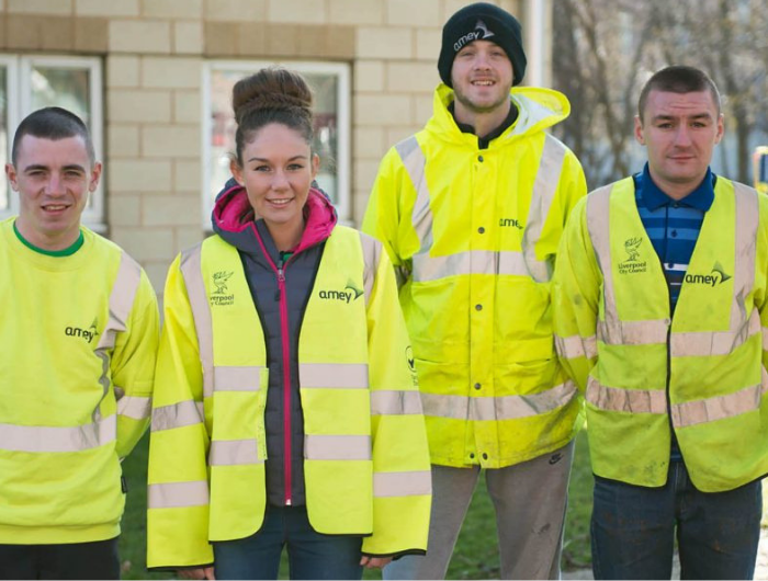 Group of 4 young apprentices in hi-vis jackets