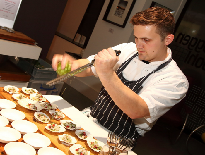 Young chef Jon preparing food