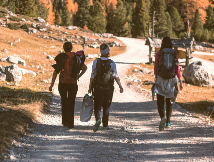 Group of three young people walking with expedition gear