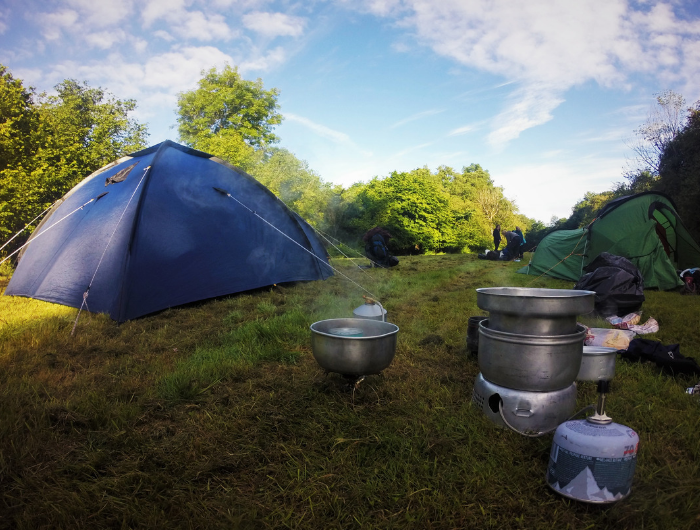 Blue camping tent and cooking equipment
