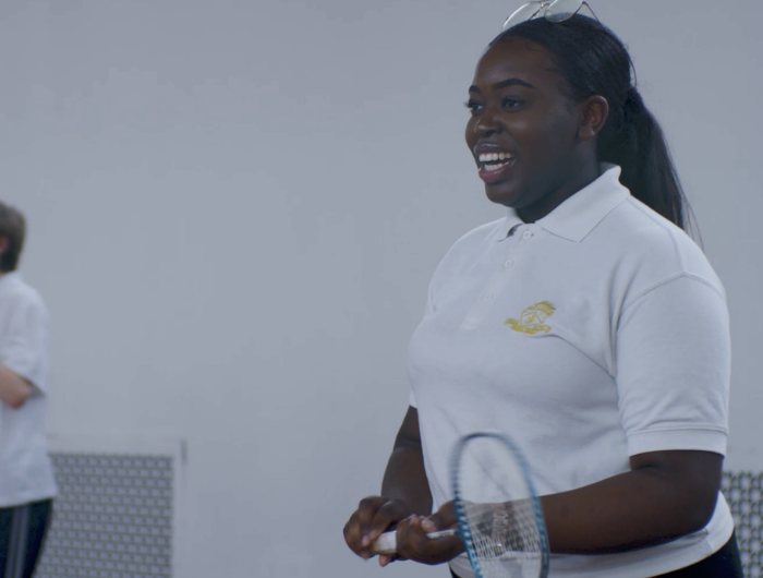 Young girl Lavine playing badminton as part of her DofE physical activity