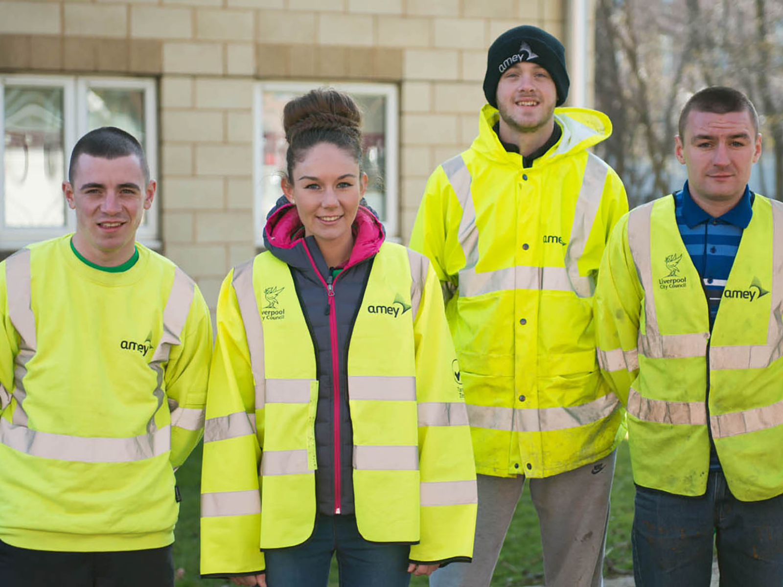 Four Amey apprentices in high vis jackets