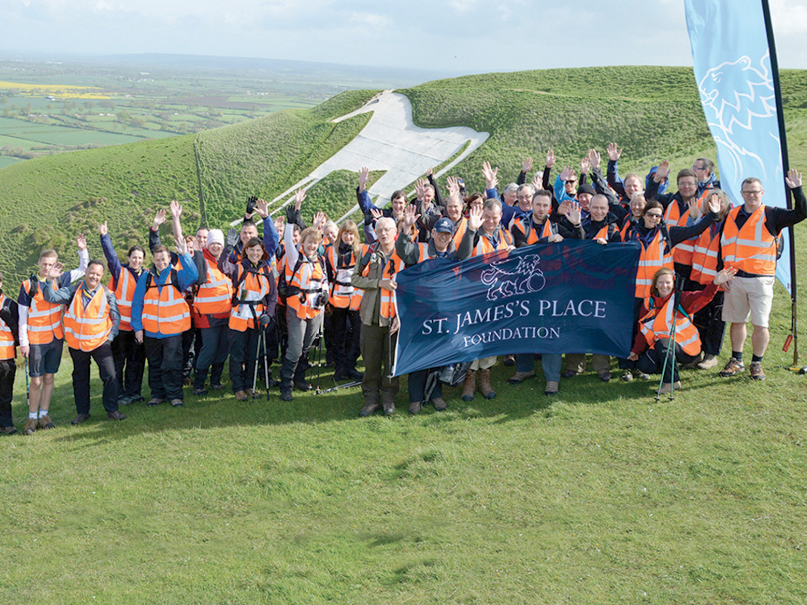 Large group of St. James's Place Wealth Management employees in the Vale of White Horse