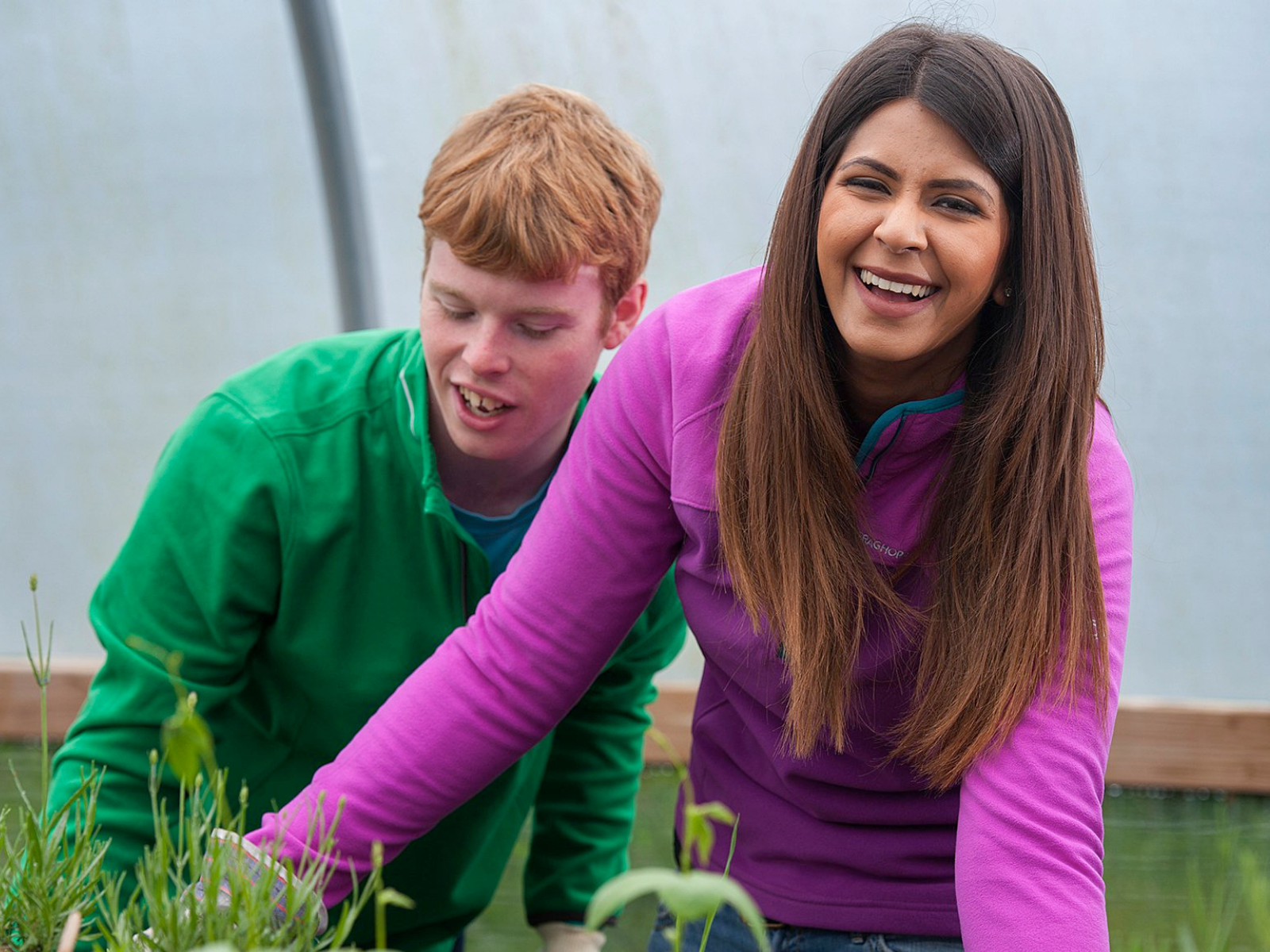 Male and female DofE participant in greenhouse gardening