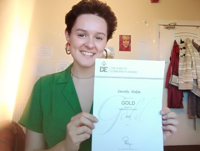 Photo of Dorothy Hakim holding her Gold Award certificate