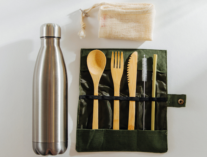 Bamboo cutlery and reusable water bottle flatlay