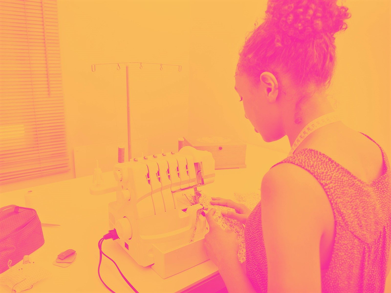 Young girl at sewing machine