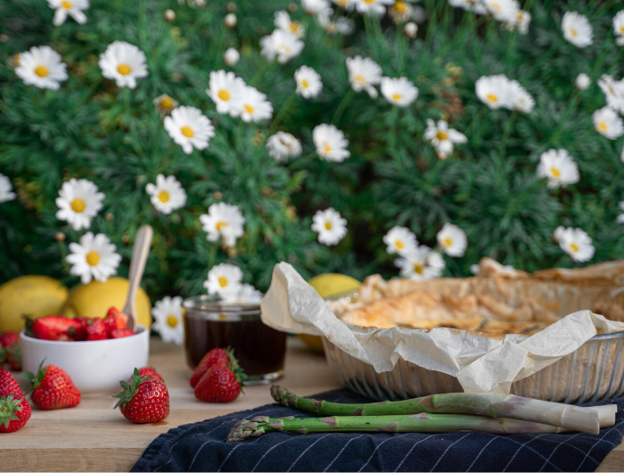 Table laid with food and daisy flowers