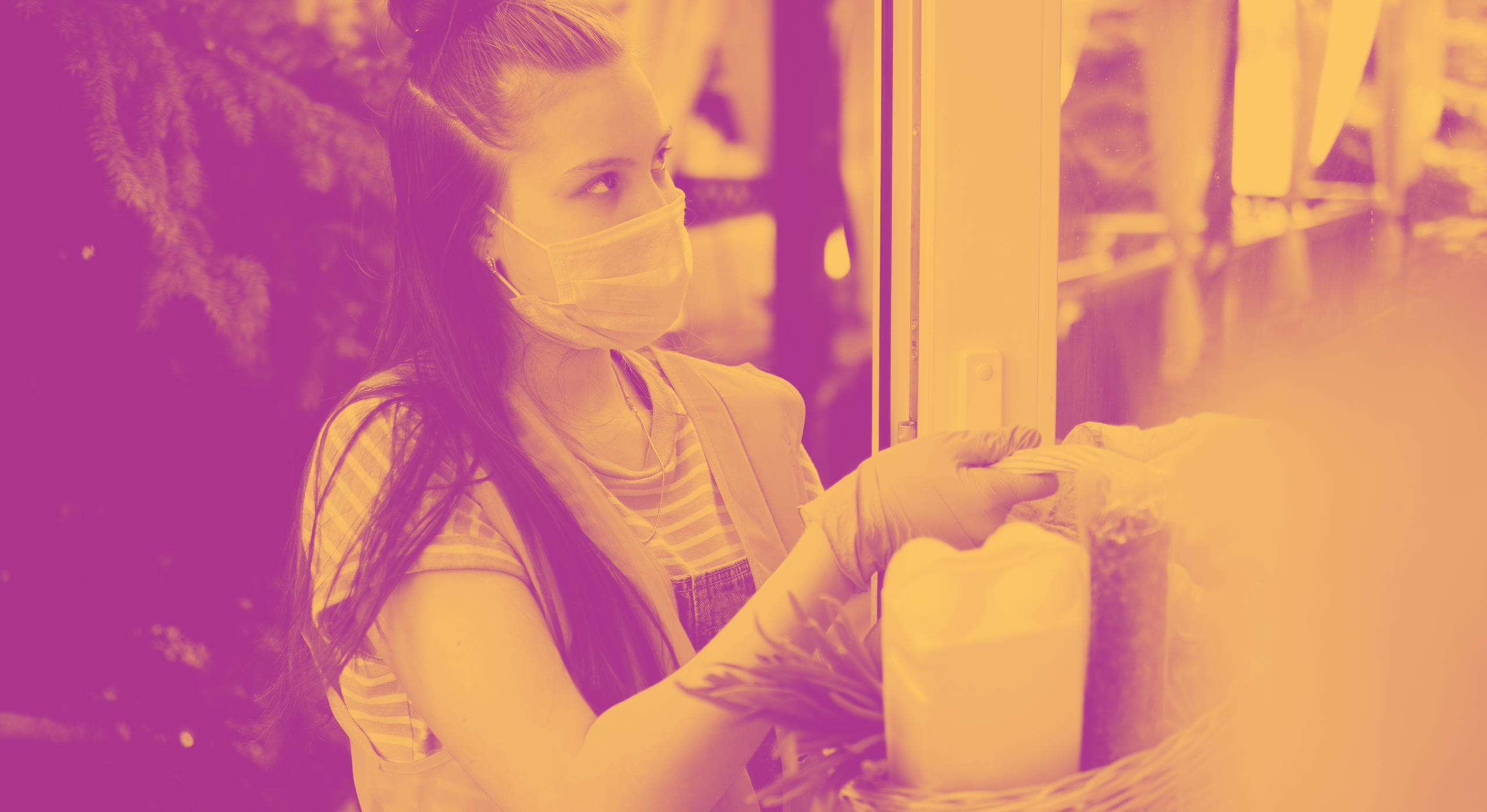 Girl in facemask volunteering a delivering food during pandemic