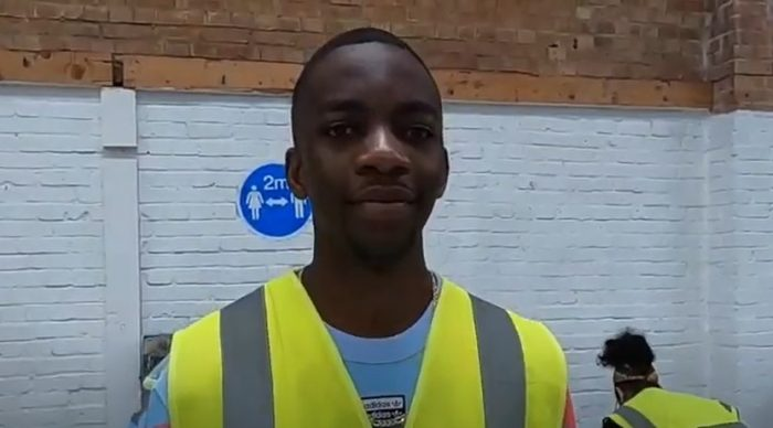 Young man smiling to camera wearing yellow high vis jacket
