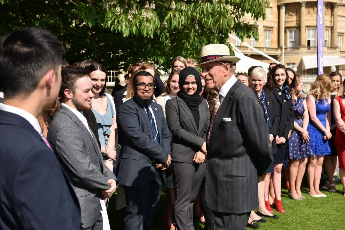 HRH Prince Philip talking to group of young people