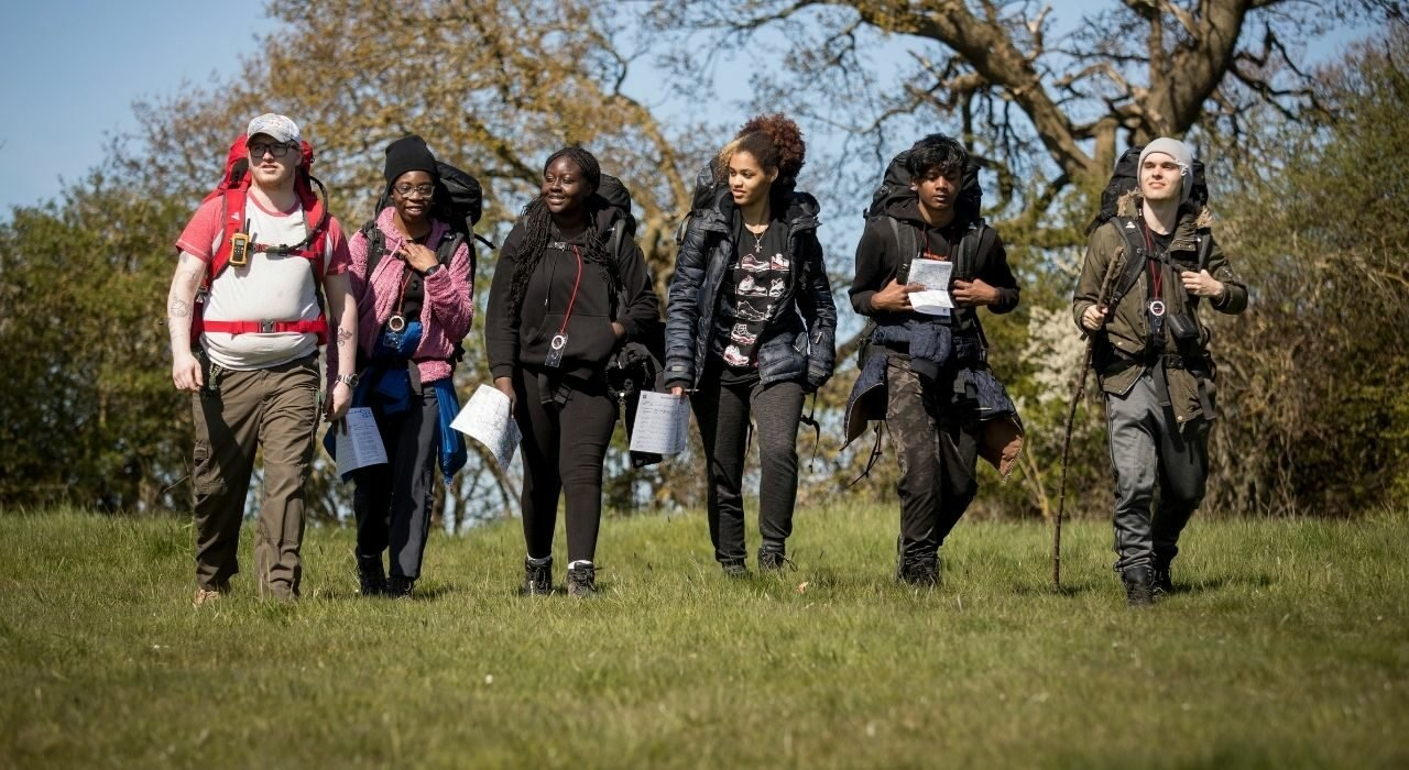 Group of young people walking on DofE expedition
